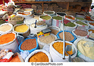 Bags of Market Food Staples - Bags of food staples in an...