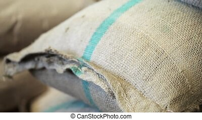Bags with coffee grains in coffee factory.