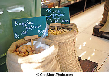 Bags with nuts at entrance of food store
