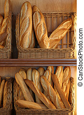 French loaves for sale in a bakery.