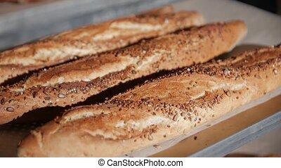 Baguetteat the bakery with cereals camera movement closeup