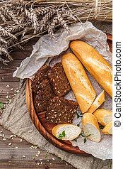Baguette, bread in wooden bowl