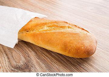 Baguette in paper bag