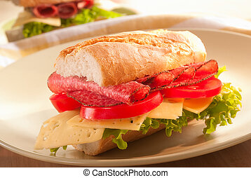baguette sandwich with salami, cheese, salad and tomato