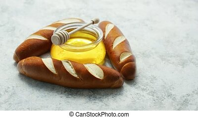 Baguettes with jar of honey - Layout of golden baguettes in...