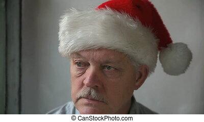 bah humbug Santa - an older man in a Santa Claus hat says...