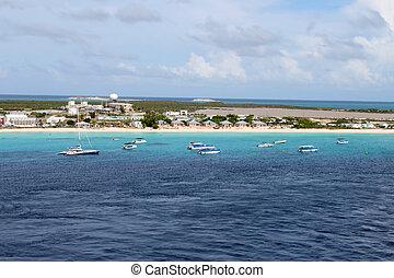 Bahamas beach - Catamarans and tour boats along the shore of...