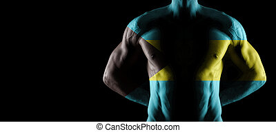 Bahamas flag on muscled male torso with abs