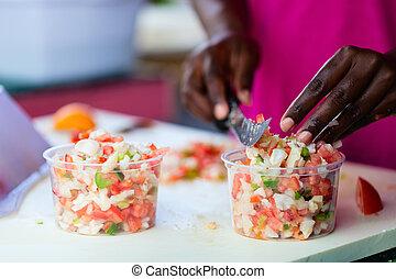 Bahamian conch salad - Close up of Bahamian woman making ...