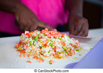 Bahamian conch salad - Close up of Bahamian woman making...