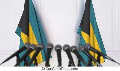 Bahamian official press conference. Flags of the Bahamas and...
