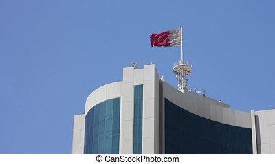 Bahrain flag on skyscraper