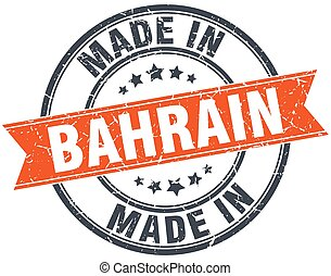 Bahrain orange grunge ribbon stamp on white