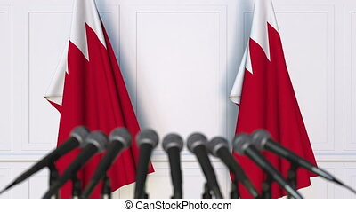 Bahraini official press conference with flags of Bahrain. 3D...
