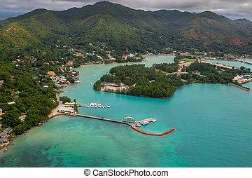 Aerial view of Baie Sainte Anne and the harbour of Praslin, Seychelles in the Indian Ocean.