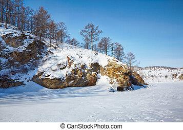 Baikal in winter - Rock in frozen siberian Baikal Lake in...