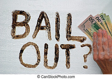 Bailout - A hand using American money to wipe out the words...