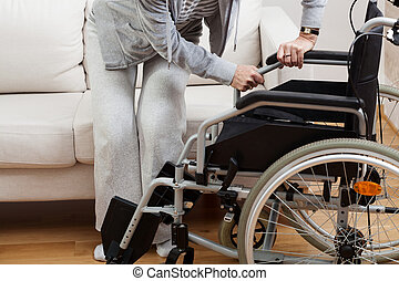 baixo, cadeira rodas, sentando