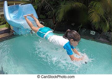 baixo, respingue, após, jovem, corrediça água, ir, menina, piscina
