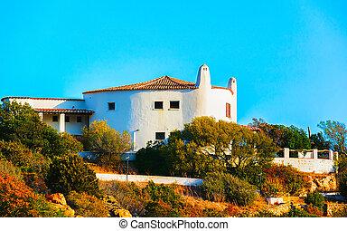 Baja Sardinia architecture and nature in Costa Smeralda reflex