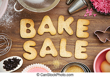 "Cookies forming the words ""bake sale"""