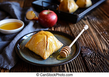 Baked apple dumplings with honey