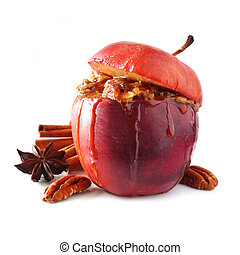 Baked apple with caramel, brown sugar and and nuts isolated on white
