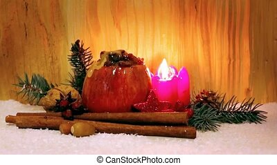 Baked apple with Christmas decoration and flowing honey.