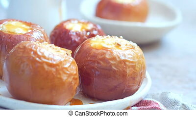 Baked apples stuffed with cheesecake and caramel