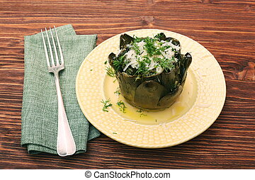 Baked artichoke on wooden background