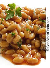 Baked Beans - Baked beans on toast, in closeup. Delicious.