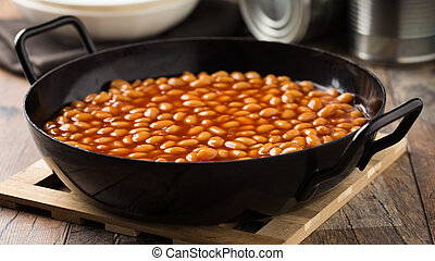 Baked Beans - Baked white beans with tomato sauce served in...