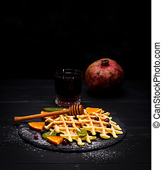 baked Belgian waffles and a glass of pomegranate juice