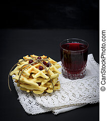 baked Belgian waffles and fruit compote in a glass