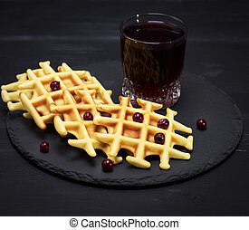 baked Belgian waffles and fruit compote