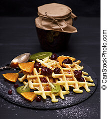 baked Belgian waffles with jam and fresh fruits