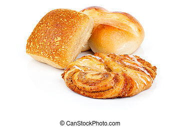 Baked bread bun and Cinnamon Rolls, isolated on white background