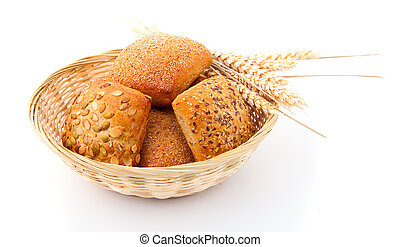 Baked bread bun in basket. isolated on white