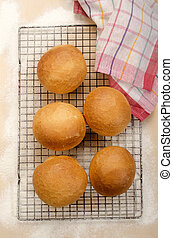 baked bread rolls on a cooling rack