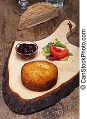 baked camembert on a wooden board