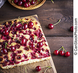 baked cherry pie on a brown wooden board