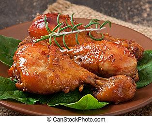 Baked chicken drumsticks in honey-mustard marinade