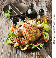 baked chicken with herbs spices ingredients, selective focus