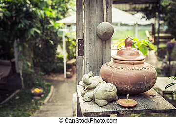 baked clay on wood table, traditional of Thailand