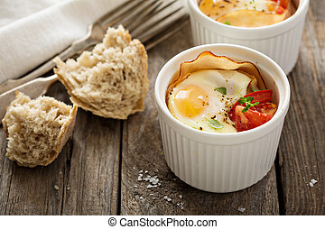 Baked eggs in small ramekin - Baked eggs with ham and tomato...