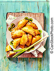 Baked Empanadas Served with Fresh Green Onions
