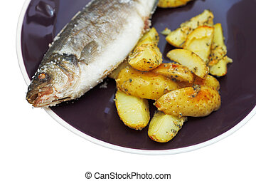 baked fish and fried potatoes on plate