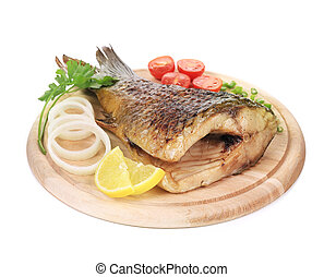Baked fish on wooden board