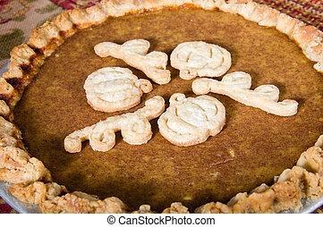 Baked fresh pumpkin pie with decoration