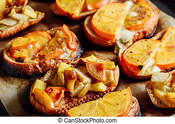 Baked Fruit Bruschettas on Baking Sheet. Food Background